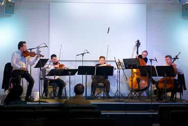 Vov Dylan Viennese Salon Orchestra performing in Humph Hall